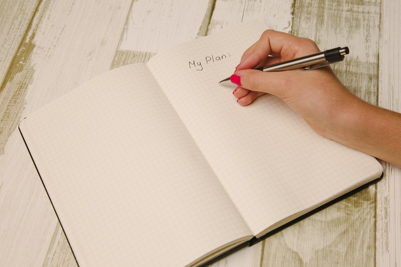 """Pink-Manicured Hand Writing List Titled """"My Plan"""""""
