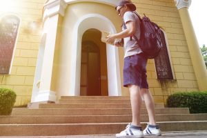 Male Student at Steps of Building